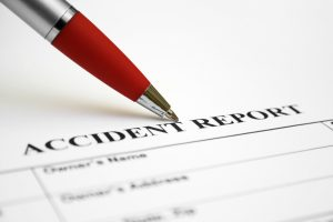 How do I ensure that a police report for the accident is filed in the absence of authorities?