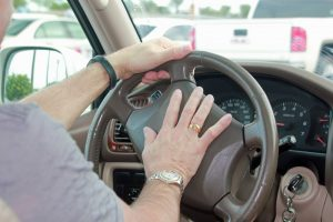 How are aggressive driving and road rage different?